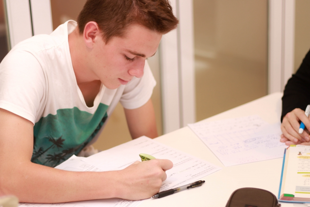 teenager taking French lessons to prepare French DELF Scolaire et Junior French IGCSE French IB HKDSE
